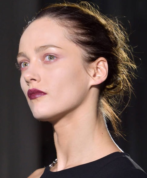 Anthony Vaccarello Disheveled Bun Hairstyle, Elle